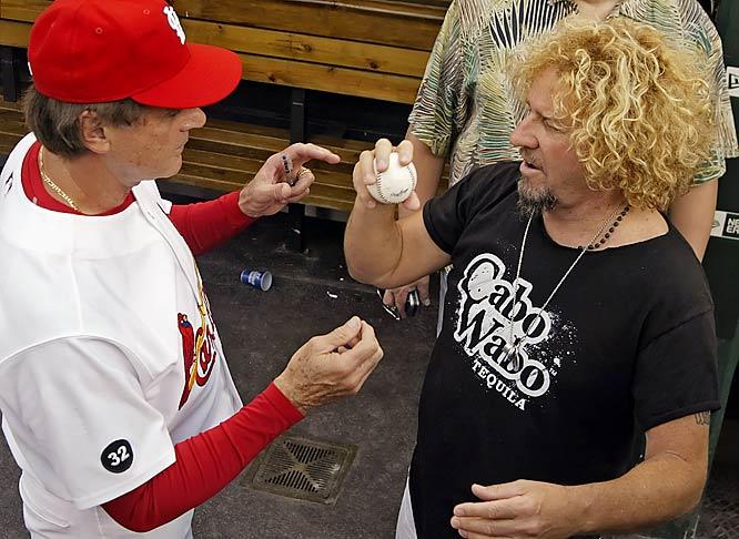 Cardinals manager Tony La Russa shows rocker Sammy Hagar how to throw 55.