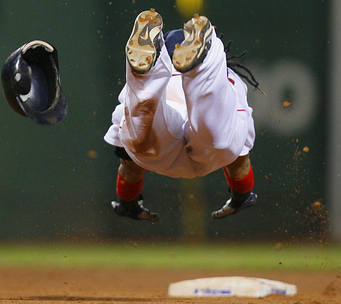 Manny Ramirez dives into second for a double in the seventh against the Yankees at Fenway Park on Sunday. Boston lost 6-5.