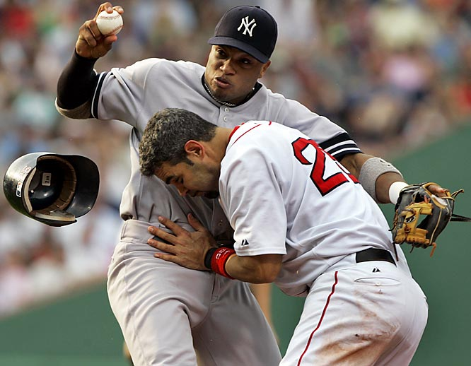 The Red Sox' Mike Lowell runs into Yankees second baseman Robinson Cano, but couldn't prevent him from turning a double play in the fourth inning Saturday at Fenway Park. The Red Sox won 11-6.