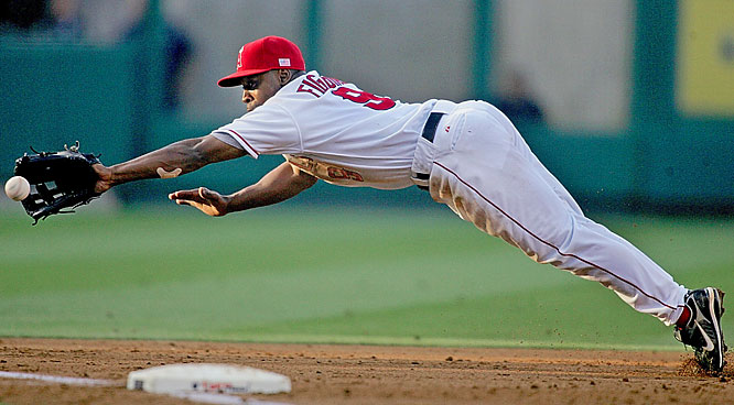 Angels third baseman Chone Figgins snags a line drive by the Mariners' Kenji Johjima during the third inning May 28 in Anaheim. Seattle won 12-5.