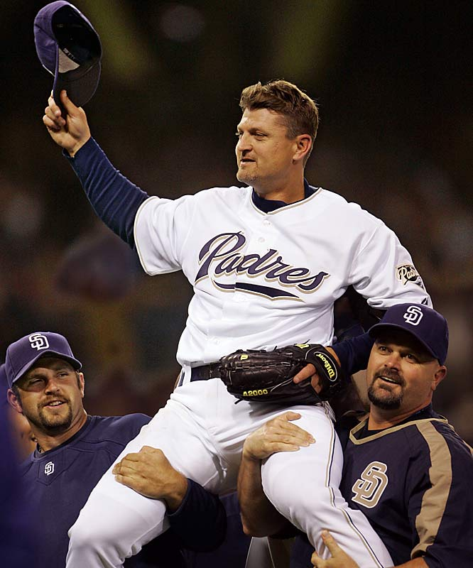 Padres closer Trevor Hoffman is hoisted by teammates Heath Bell, left, and David Wells, right, after saving his 500th career game in San Diego's 5-2 victory over the Dodgers at PETCO Park on June 6.