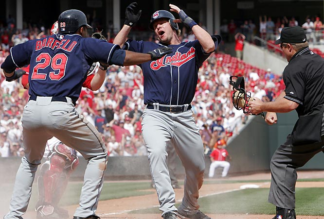 The Indians' Jason Michaels reacts as he is called out by umpire Marvin Hudson in the 12th inning against the Reds on Sunday. Alex Gonzalez hit a run-scoring single in the bottom of the 12th to give Cincinnati a 1-0 win.
