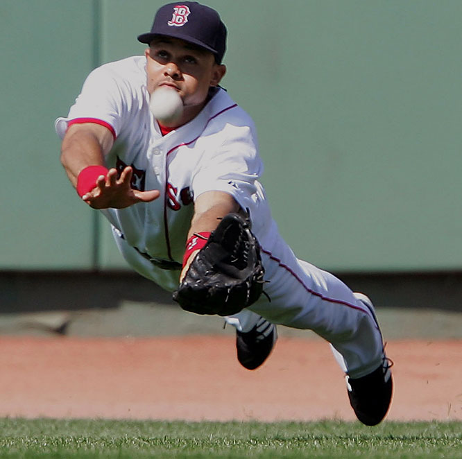 Red Sox centerfielder Coco Crisp makes a diving catch for the out against the Giants at Fenway Park on Saturday. Boston won the game 1-0 and went on to sweep San Francisco in their three-game series.