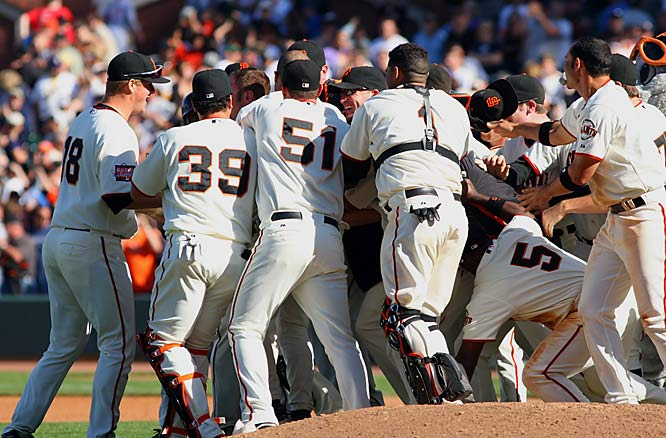 The Giants celebrate rookie Nate Schierholtz's two-out RBI single in the 13th inning for a 6-5 victory over the Yankees on Saturday. The win ended a season-high eight-game losing streak for San Francisco.
