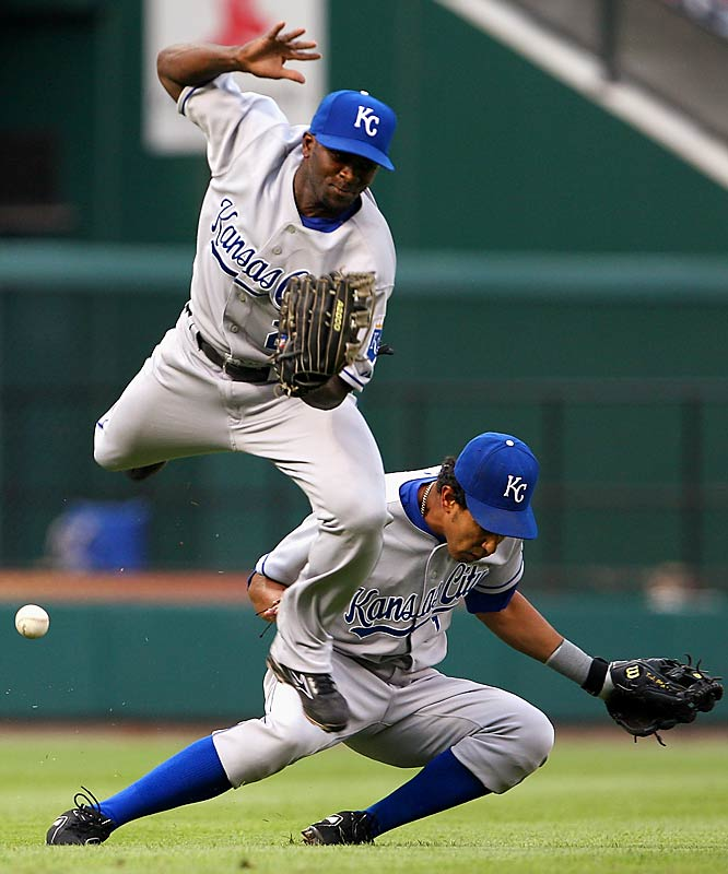 Royals' leftfielder Joey Gathright, left, collides with shortstop Tony Peña as both attempt to play a single by the Cardinals' Aaron Miles in the first inning on June 20 at Busch Stadium. St. Louis won 7-6 after a solo home run by Ryan Ludwick in the bottom of the 14th.