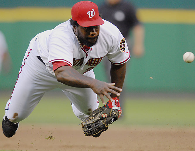 Nationals' first baseman Dmitri Young tosses the ball to pitcher Matt Chico to get Grady Sizemore out in the third inning Saturday at RFK Stadium. Cleveland won 4-3.