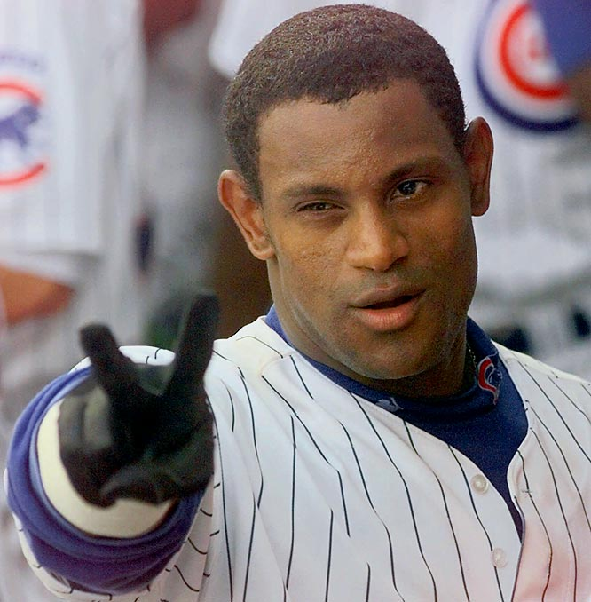Sosa gives his trademarked celebration -- the chest-thumping peace sign -- after belting No. 62 on Sept. 13, 1998.