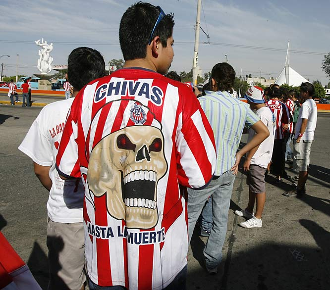 Chivas de Guadalajara fans gather at the Fuente Olímpica (Olympic Fountain) three hours before the start of the Guadalajara derby between Chivas and Atlas on April 14. Hundreds of fans later took over the road from cars and marched a mile down the Calzada Independencia to the stadium, the Estadio Jalisco. Chivas won the Mexican league rivalry game 2-0.