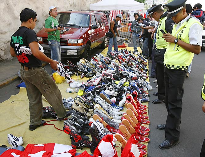 A mountain of soccer shoes is on sale outside the Estadio Nemesio Diez in Toluca before the Red Devils' 2-0 home loss to eventual champion Pachuca on April 15. Located about 40 miles west of Mexico City, the stadium has the highest altitude of any in the Mexican top flight (8,790 feet, or 2,680 meters) and will not be allowed to host any international matches due to the new FIFA rule banning internationals held above 2,500 meters.