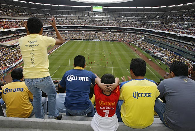 High above Mexico City's legendary Estadio Azteca, fans of Club América cheer on their *Águilas* (Eagles) in a 2-1 Copa Libertadores victory against El Nacional of Ecuador on April 18. Drawn by a deal promising all tickets for 50 pesos (around $5) each, more than 60,000 fans show up for a Wednesday game in the 105,000-seat stadium made famous by Pelé and Diego Maradona in the 1970 and 1986 World Cups.