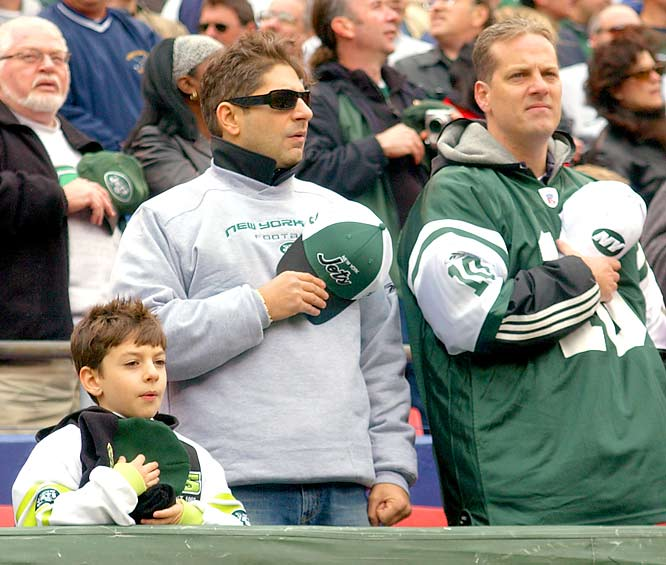 Jets fan Michael Imperoli (Christopher Moltisanti) stands for the national anthem at Giants Stadium prior to a New York win over San Francisco in 2004.