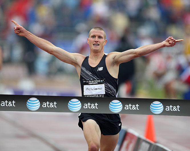 Joshua McAdams celebrates winning the steeplechase in a time of 8:24.46.