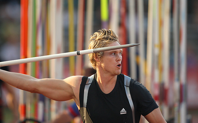 Breaux Greer's throw of 299 feet, 6 inches broke his own American record, set only a month ago.