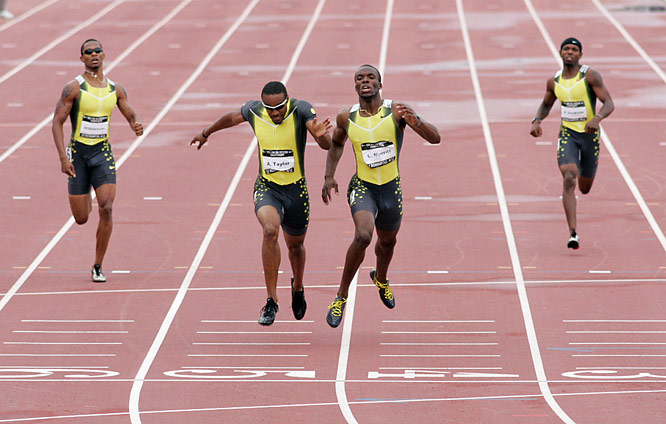 Angelo Taylor (left) and LaShawn Merritt sprint for the finish in the 400. Taylor held on to win in a time of 44.05 seconds.