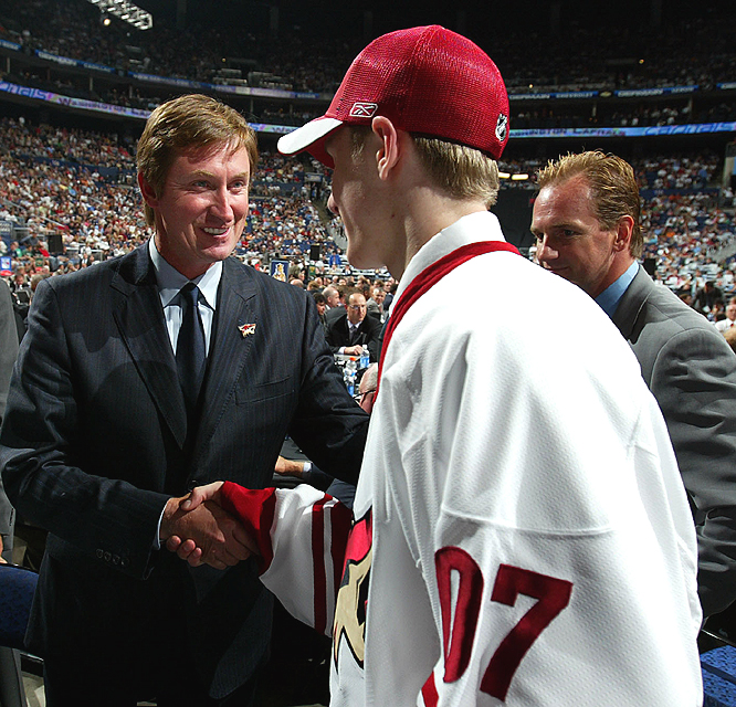 The highly touted center who's already committed to play at the University of Wisconsin, shakes hands with Wayne Gretzky after being selected.