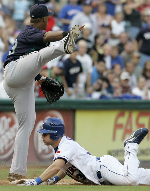 Mariners third baseman Adrian Beltre picks an odd time to start doing his calisthenics.