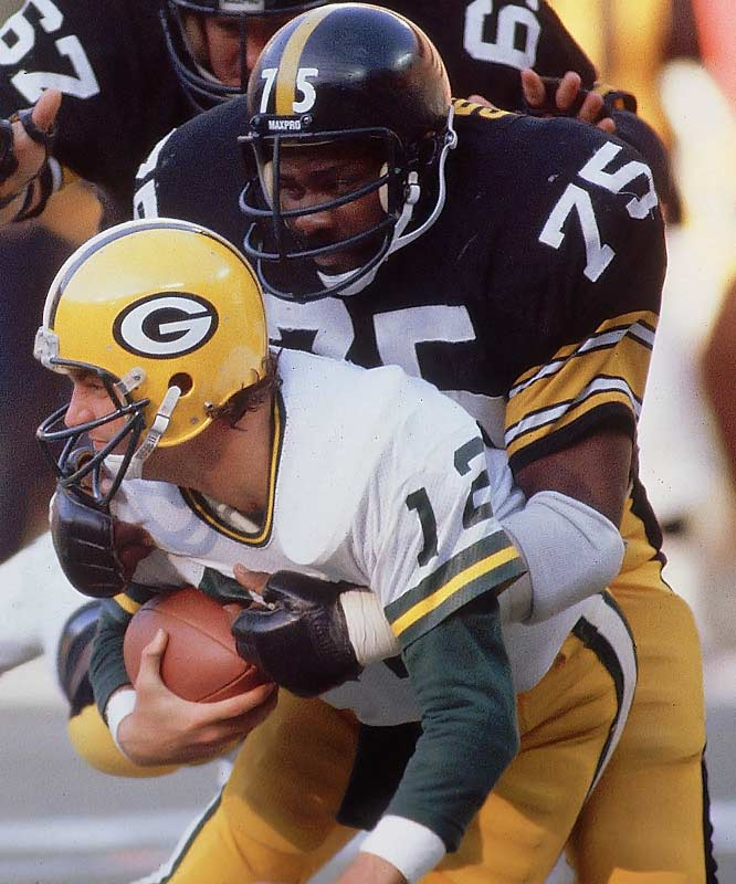 1969-1981 Pittsburgh <br><br>The cornerstone of Pittsburgh's Steel Curtain defense, Greene was blessed with size, speed, strength, quickness and determination. In 1974, he developed the tactic of lining up at a sharp angle between the guard and center to disrupt their blocking assignments and leave him free to punish the offense.