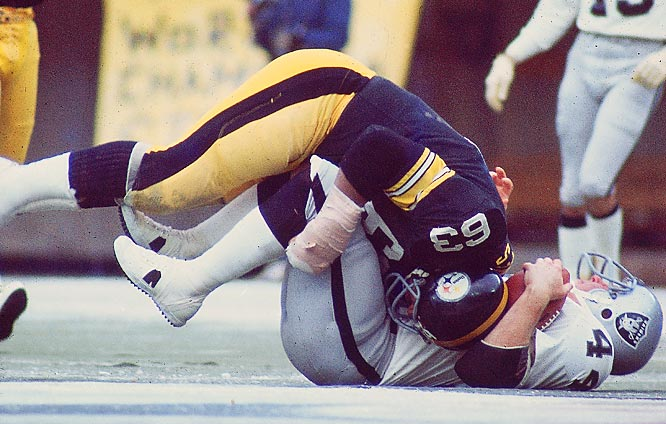 "1972-1977 Pittsburgh, 1978 New England  <br><br>Holmes was sometimes overshadowed by his fellow Steel Curtain defenders, but he hit as hard as the rest of them -- and dwarfed most of them in size. ""I don't mind knocking somebody out,"" Holmes said in 1975. ""If I hear a moan and a groan coming from a player I've hit, the adrenaline flows within me. I get more energy and play harder."""