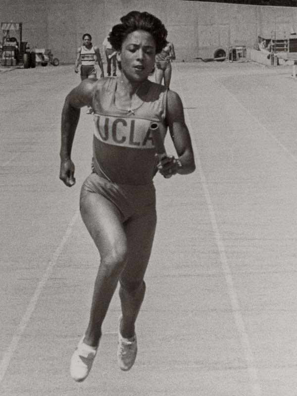 Flo-Jo, who trained with legendary track coach Bob Kersee while at UCLA, won NCAA individual titles in the 200-meter and 400-meter in 1982 and 1983, respectively, earning her a spot on Team USA for the 1984 Olympics.