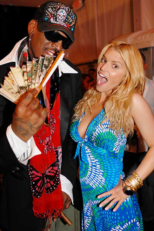 We can only imagine what Dennis Rodman said to Jessica Simpson at her swimwear show earlier this week.
