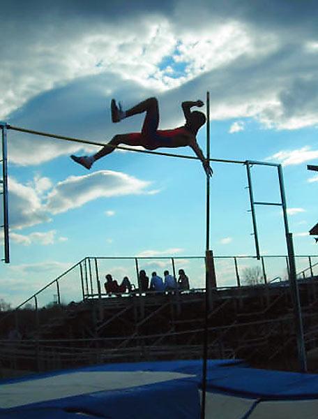 A Broomfield High (Connecticut) pole vaulter clears 11-6.
