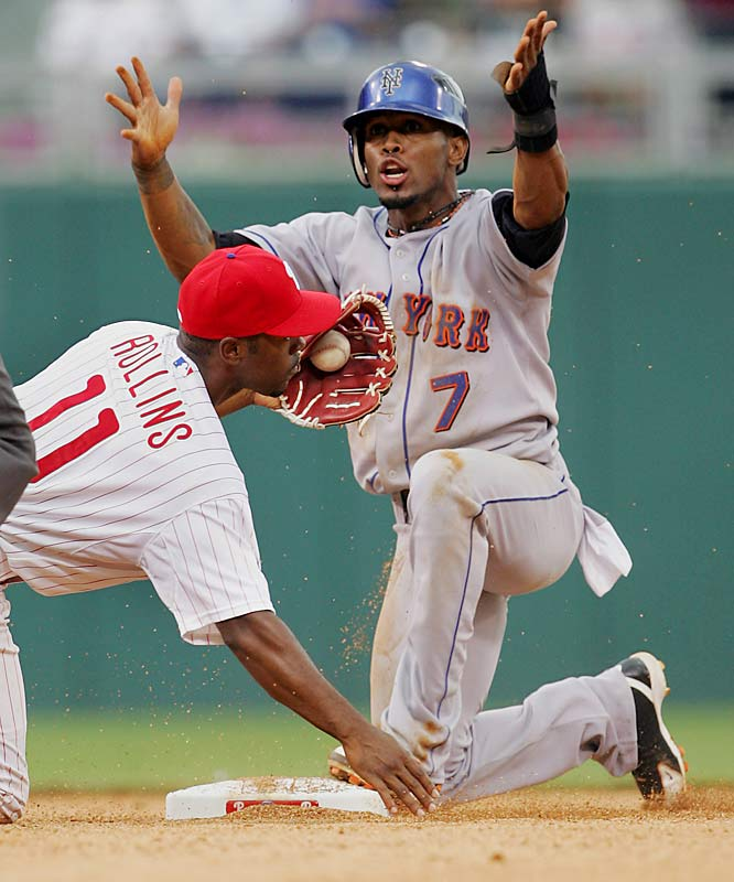 Jose Reyes pleads with second base umpire Dale Scott after being tagged out by Phillies shortstop Jimmy Rollins on a stolen base attempt during the first game of a doubleheader on June 29 at Citizens Bank Park. The Mets won 6-5.