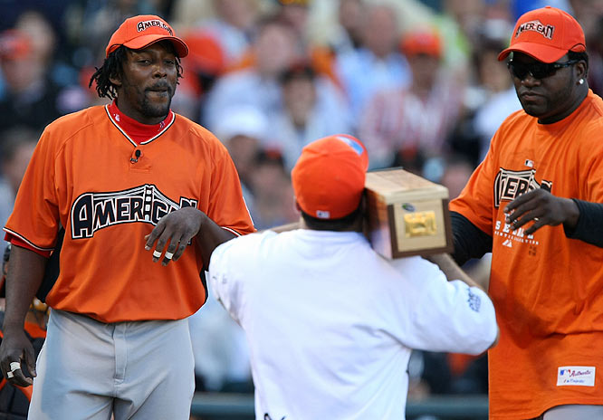 After recording four outs without homering, Angels outfielder Vladimir Guerrero accepted a gift bat from Red Sox slugger David Ortiz and went on to hit five to advance to the second round.
