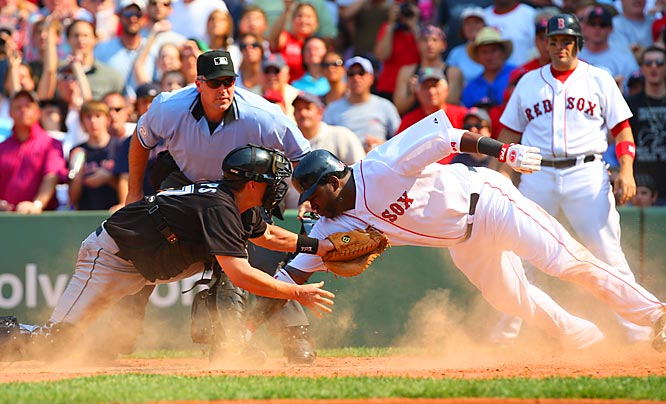 Jason Phillips of the Blue Jays tags out David Ortiz in the sixth inning Sunday at Fenway Park. Ortiz was trying to score from second on a hit by Eric Hinske during a game in which Toronto would win 2-1.
