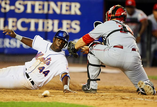 Lastings Milledge scores the go-ahead run from first on a single by Ruben Gotay as Cincinnati's David Ross is late with the tag in the fifth inning July 12 at Shea Stadium. The Mets held on to win 3-2.