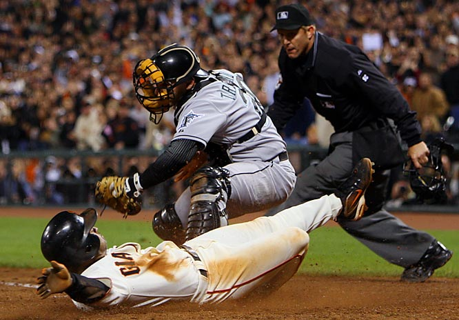 Dave Roberts beats the tag by Florida's Matt Treanor to tie the score at 3 in the bottom of the ninth Saturday at AT&T Park in San Francisco. The Giants won 4-3.