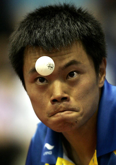 The new comedy movie <i>Balls of Fury</i> portrays Ping-Pong as an extreme sport, but judging by the faces on these players, it already is.