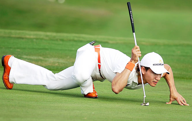 Camilo Villegas lines up a putt at the Ford Championship at Doral in 2006.