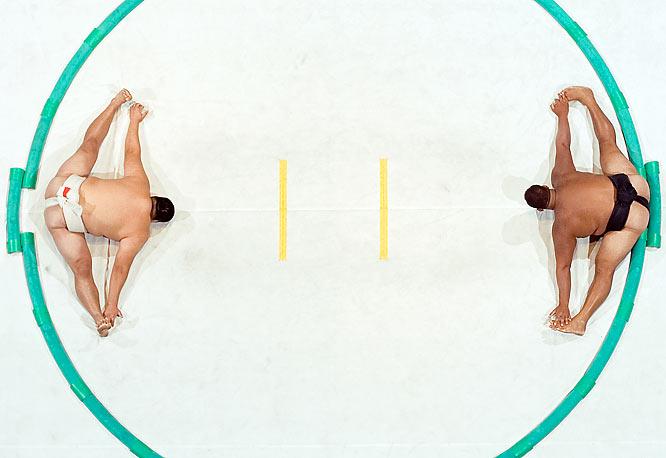 Bayanbat Davaadalai of Mongolia and Wayne Vierra of Hawaii stretch at the U.S. Sumo Open in 2007.