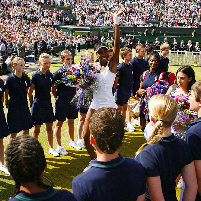 Venus Williams became the first woman to receive the same paycheck as the men's champion at the All England Club.