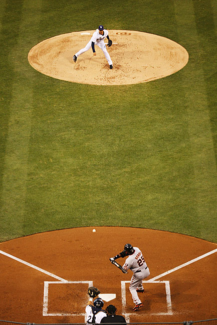 Bonds starting a swing off Padres' pitcher Clay Hensley in the second inning.