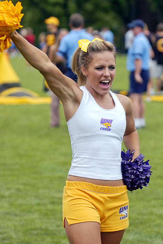 Lindsey Rhodes from Northern Iowa University performs during her sideline cheer private instruction.