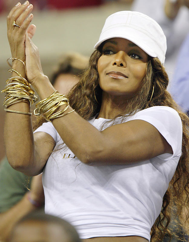 Janet Jackson attended a sporting event and kept her top on. The pop singer took in some U.S. Open action on Monday.