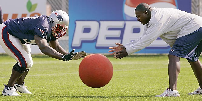 Patriots defensive line coach Pepper Johnson, right, and Jarvis Green think the ball is just gonna come to them.