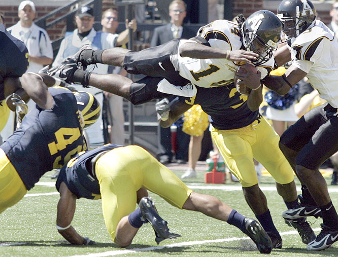 Quarterback Armanti Edwards (14) and the Mountaineers became the first I-AA team to beat an AP Top 25 team as they stunned the Wolverines in the Big House.