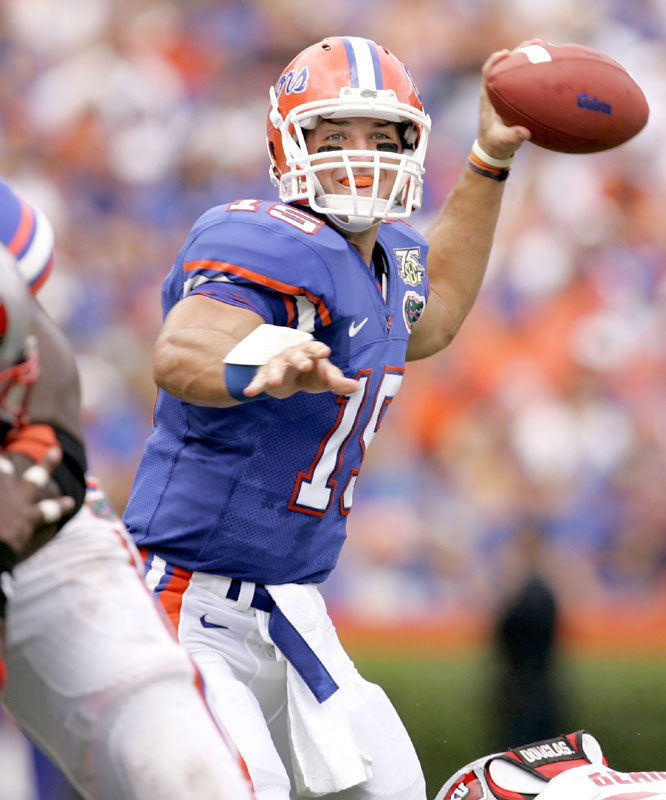 Tim Tebow threw for 300 yards and three touchdowns and ran for another score as the defending champions opened the season with a win that was called with 8:23 left in the fourth quarter because of lightning.