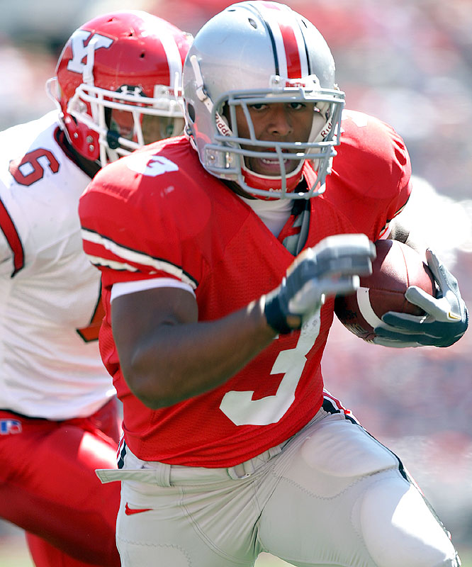 Brandon Saine ran for 42 yards and a touchdown as the Buckeyes gave coach Jim Tressel a win over the team he coached for 15 years.