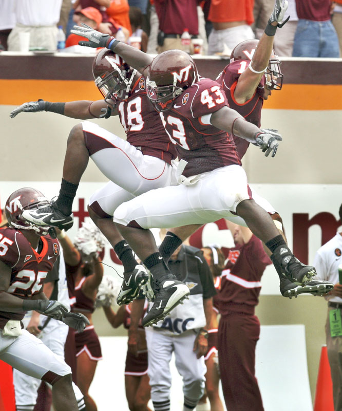 Victor Harris (1) scored the Hokies' first touchdown on a 17-yard interception return, giving Virginia Tech the win in an emotional game that opened with a tribute to the victims of the April shooting.