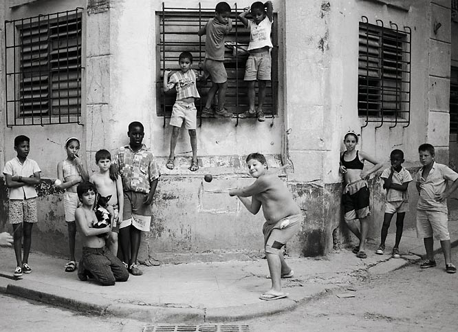 Walter's take: ''This is a picture that you take once in your life. I got it with a 50mm lens, which I almost never use. I don't like normal lenses. And I shot no more than 24 frames on this scene. It wasn't set up. I was in Havana, and I just kept asking kids to bat. The picture is all about the joy of sport. Every eye -- and I mean every one, including the dog's -- is on the ball. This is one of my favorite images, and one of the best assignments I ever had. Cuba's a gold mine for photography.''  Shot with: Canon EOS Rebel G SLR Camera Kit, EF 35-80mm