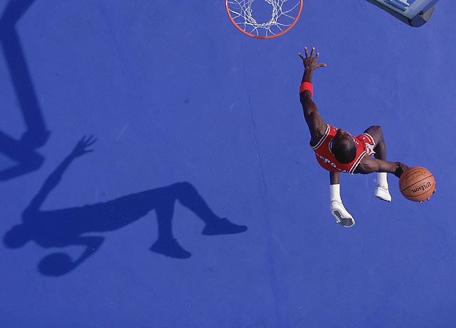Walter's take: ''I call this one 'Blue Dunk'. We were in Lisle, Ill. I painted one parking lot red and one blue. Which one we used would depend on which uniform Michael wore to the shoot. I also brought in an NBA basket so we could roll it around and cast the shadow just right. I was in a cherry picker, waiting for the sun to break in between the clouds. That whole angle of light only lasts about 15 minutes; otherwise it's either too high or too low. I've shot Michael for a long time, but I like this shot because in it, he's young and full of pep. It's 1987, which was a long time ago. He still had hair. There are other Jordan shots I've taken that I like, but this one's sorta my favorite.''  Shot with: Canon New F1 (14 frame-per-second high-speed camera) EF 50mm