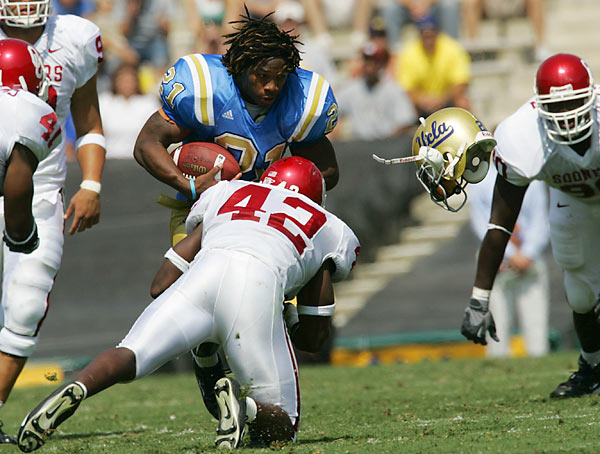 This game was billed as an early-season showdown, but UCLA made it look easy while upsetting No. 21 Oklahoma, 41-24, at the Rose Bowl. It was a tough, well-played game, and occasionally helmets flew. At least this guy's head stayed on.<br><br>Shot with: Canon EOS-1D Mark II, EF 500mm f/4L IS USM, shot at 1/1000 at f/5.6
