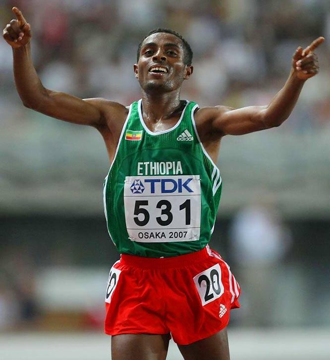 Kenenisa Bekele celebrates after winning the 10,000  on Day 3.