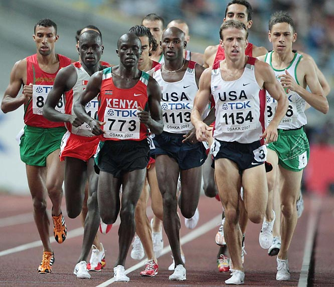 In his first big race as an American, Kenyan-born Bernard Lagat (1113) gives the U.S. its first 1,500-m title at the worlds. He won the gold with a time of 3:34.77.