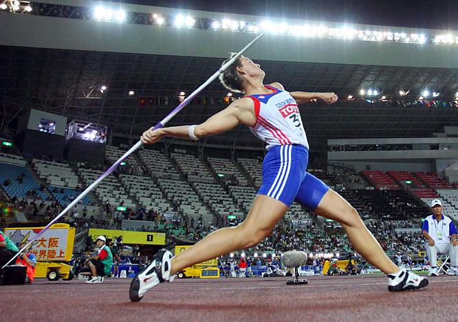 Barbora Spotakova (CZE) wins  the world javelin throw title, with a  mark of 67.07.