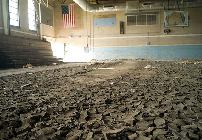 The gym floor at Lawless buckled during the flooding and remains covered in debris.