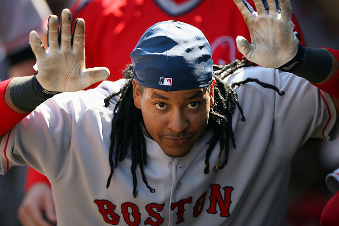 Manny Ramirez acts like a bull in the dugout following his solo home run in the fifth inning against the Mariners at Safeco Field on Sunday. The Red Sox won 9-2.